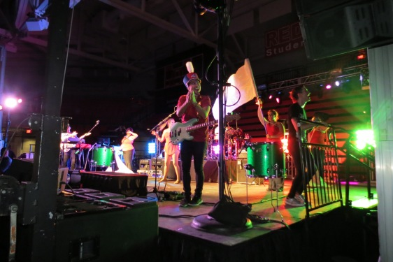 "Walk the Moon bassist Kevin Ray performs ""Shut Up and Dance"" while sporting a Spirit of Stony Brook Marching Band Shako! Photo courtesy of @sbumarchingband"