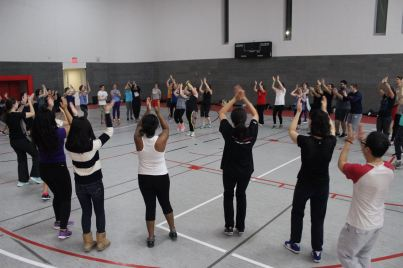 Zumba students dance and workout in a circle to one of the many routines they learned during the 90 minute master class.